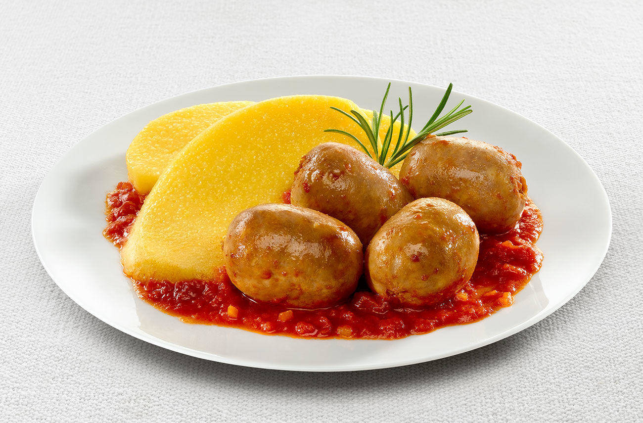 Polenta with sausage and tomato